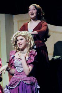 Cinderella (Tatum Ludlam) prepares Florinda's (Clair Leon) hair.(Studio East)
