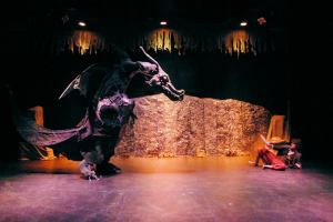 "Smaug and Bilbo (Robert Kinsfather) square off. ""The Hobbit – A Musical""  at Studio East."
